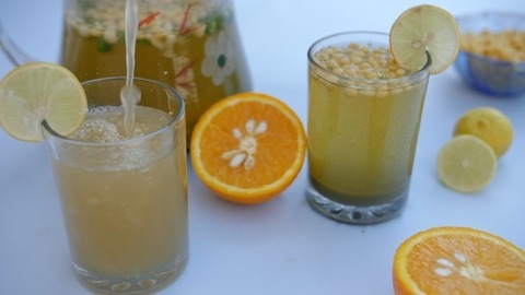 Cool Indian Rajasthani drink Jaljeera pouring in a clear glass - a refreshing summer drink