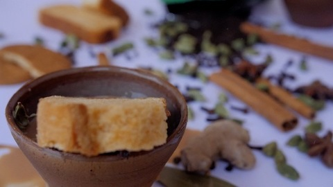 Sweet crunchy rusk falling in an earthen cup with boiling hot tea made at home - Chai culture in India