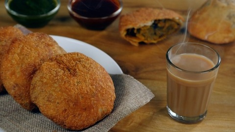 Crispy Kachodis served a glass of boiling hot tea for breakfast / evening snacks