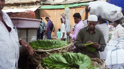 Chennai, Tamil Nadu, India - February 10, 2020: A street vendor selling fresh betel leaves / Paan on the by lanes of a marketplace
