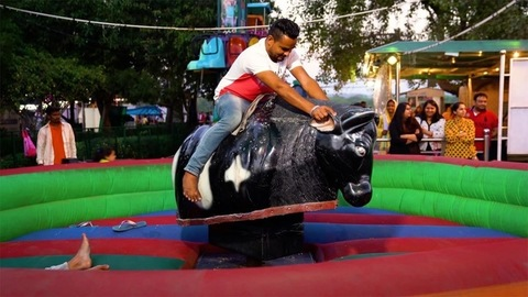 Chandigarh, India - June 17, 2020: Portrait of a youngster in his mid-thirties having fun while riding an animal carousel
