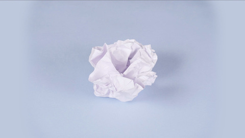 Stop motion shot of a white sheet of paper crumpling and unfolding again - Time lapse shot