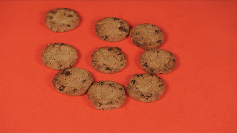 Stop motion shot of delicious homemade cookies arranged nicely in a pattern - Time lapse shot