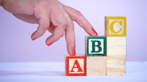 Alphabets made with wooden blocks - step by step learning. Kindergarten learning