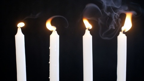 White candles burning brightly to mark as a symbol of peace and harmony