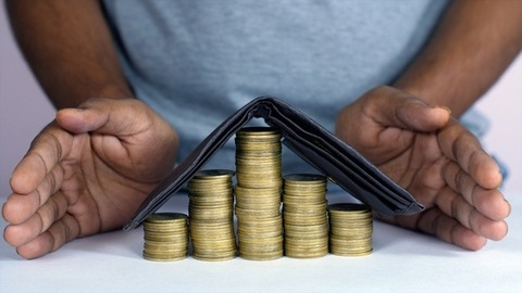 Indian businessman in casual clothes - saving money and financial planning