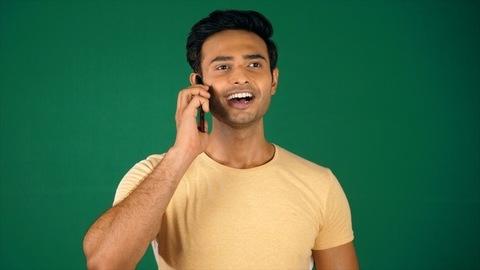A happy businessman receiving a phone call, Chroma shoot - modern technology