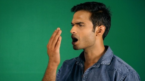 Handsome man having bad breath issues - medical treatment. Green screen / Chroma shoot