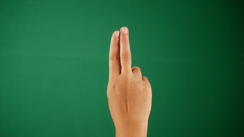 Fingers of a youngsters hand tapping against the green screen - hand gestures