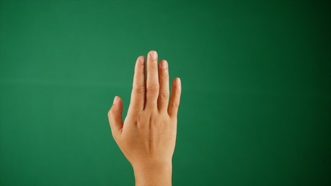 A beautiful youngster waving his / her hand against green screen