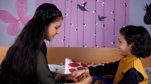 Cute sister celebrating Rakshabandhan with her sweet little brother - festive season