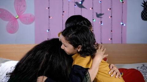 Caring pretty sister hugging her younger brother on a special occasion - Rakhi festival - Raksha Bandhan