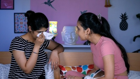 An upset Indian girl is in pain / sorrow after a breakup - relationship problems