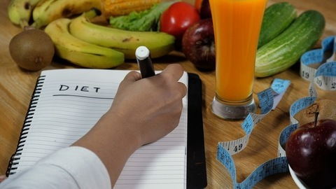 """Nutritionist making a """"Diet Plan"""" for weight loss journey"""