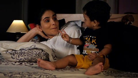 Loving young mother petting her little daughter while sleeping