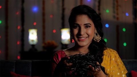 Beautiful Indian woman holding a set of decorative lights - Diwali celebrations