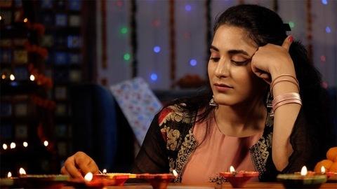 Young Indian girl - Sad during Diwali celebrations