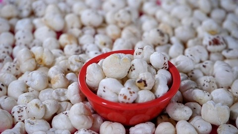 Heap of plain white fox nuts / lotus seeds stacked together - a tasty snack
