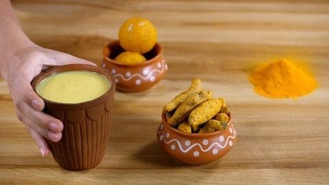 Chilled haldi milk served in an earthenware glass - Golden milk