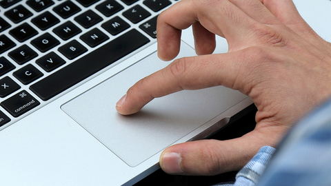 Close up of hands scrolling on Laptop touch pad - Pinch in, Pinch out, Zoom