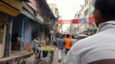 Fast motion of a crowded street, view from a rickshaw