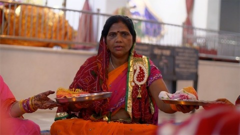 Married Indian woman doing Pheri rituals with decorated Karwa Chauth puja thalis