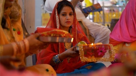 Married females performing Pheri rituals on the occasion of Karwa Chauth festival