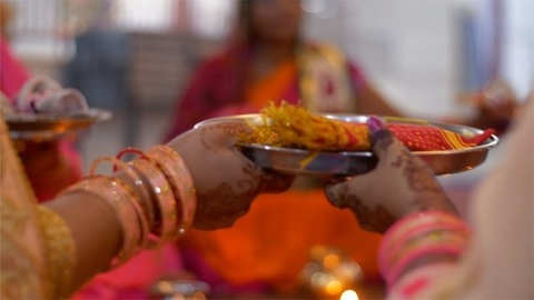 Group of women praying together at a temple on Karvachauth - Indian Hindu Tradition
