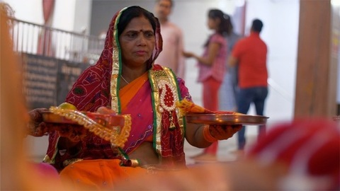 Karvachauth - Shot of mid-aged Indian woman praying for her husband's long life