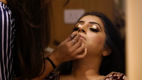 An Indian girl is getting ready for her wedding