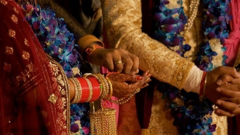 Shot of a man giving puffed rice in the bride's hands on her special wedding day