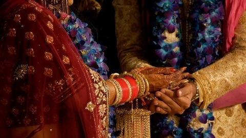Indian wedding ritual - Bride and Groom holding each others hand