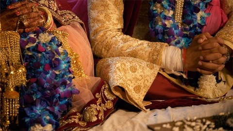 Traditional Indian couple sitting together during their wedding ceremony