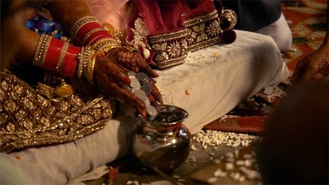 4K stock footage of the Indian bride performing a wedding ritual