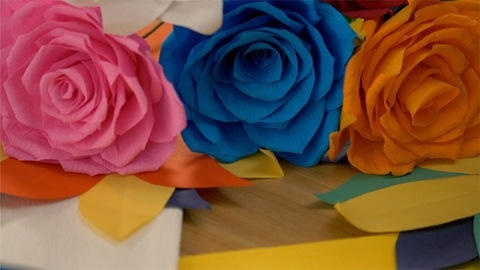 Colorful flowers made using paper cutting along with big roses