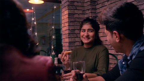 A group of Indian friends happily talking and enjoying in a restaurant - friends lifestyle