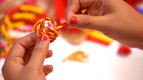 Professional jewelry designer designing handmade earrings in her workshop