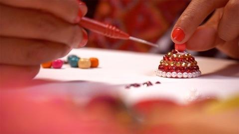 Closeup shot of a female making handmade earrings at home