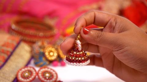 A female holding beautiful handmade earrings in her hand