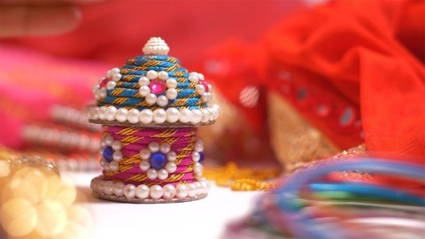 A young woman covering a beautiful handmade jewelry box kept on the table