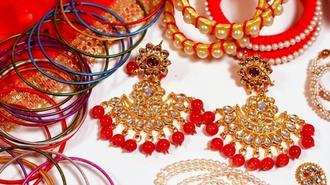 Fashionable jewelry collection displayed for sale on the counter of a jewelry store