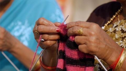 Indian woman knitting wool with knitting needles - Lifestyle women