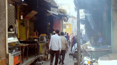 Unidentified people walking through the crowded streets of an Indian market