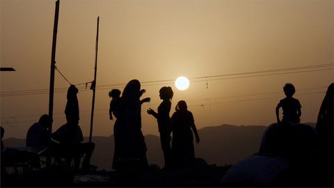 A silhouette shot a regular sunset scene in an Indian village