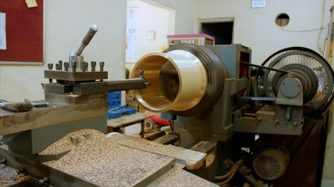 Wide shot of a lathe machine in action