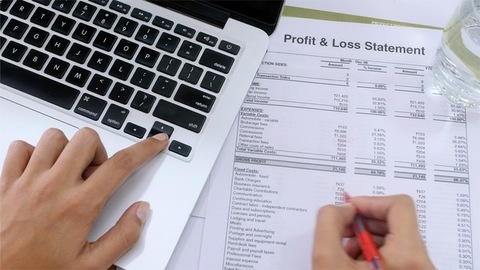 Top angle shot of a business women checking profit and loss statement / income report