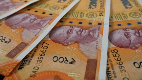 Closeup shot of Indian Currency - Rupee 200 revolving on a table