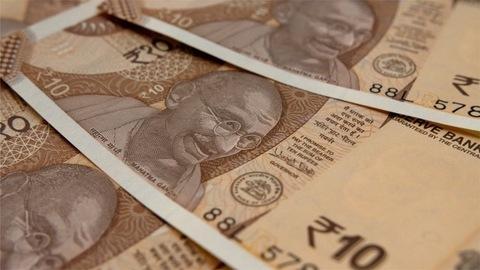Closeup shot of revolving 10 rupee Indian money
