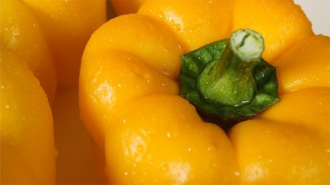 A close up shot of yellow capsicum rotating in anti clockwise direction