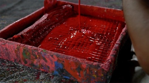 Block Printing - A man adding red fabric dye on the tray